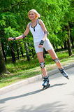 Girl roller-skating in the park Stock Photos