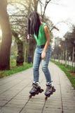 Girl roller skating in park Royalty Free Stock Image