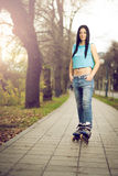 Girl roller skating in park Royalty Free Stock Images