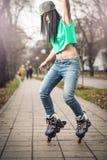 Girl roller skating in park Stock Images