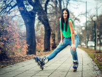 Girl roller skating in park Stock Photography