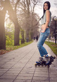 Girl roller skating in park Royalty Free Stock Photography