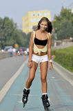 Girl roller-skating in the street Stock Photo