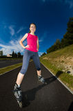 Girl on rollerblades Stock Image