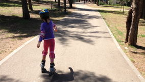 Girl on rollerblades stock video footage
