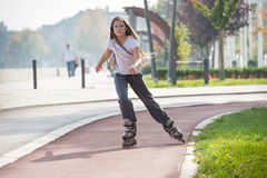 Girl on the rollerblades Royalty Free Stock Photo