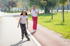 Girl on the rollerblades Stock Photos