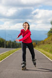 Girl on rollerblades Royalty Free Stock Images