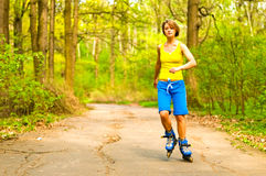 Girl on rollers royalty free stock photos