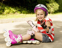 Girl on the rollers fell Stock Image