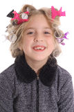 Girl with rollers in hair. Photo of a little girl with rollers in her hair Royalty Free Stock Image