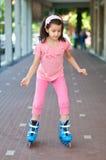 Girl rollerskating Stock Images