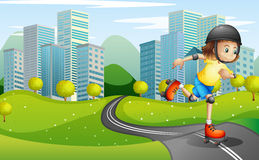 A girl rollerskating at the road with a safety helmet Stock Photos