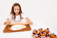 Girl rolling out dough for cakes, free space Royalty Free Stock Photos