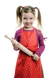 Girl with rolling-pin Royalty Free Stock Photos