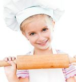 Girl with rolling pin Stock Image