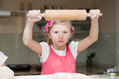 Girl with rolling pin Royalty Free Stock Image