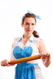 Girl with rolling pin in hand Stock Images