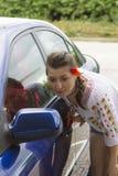 Girl in Romanian blouse near car Stock Photography
