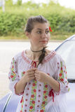 Girl in Romanian blouse near car Stock Images