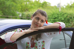 Girl in Romanian blouse near car Stock Photo