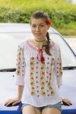 Girl in Romanian blouse near car Stock Photos