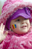Girl with Romanian flag face-painted Stock Photo