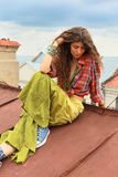Girl on a roof Royalty Free Stock Images
