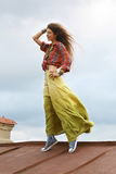 Girl on a roof Royalty Free Stock Photo