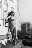 Girl on roof Stock Photo