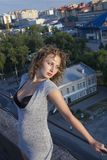 Girl on roof Royalty Free Stock Image