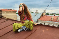 Girl on a roof Stock Photos