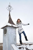 Girl on the roof. In the winter Royalty Free Stock Photography