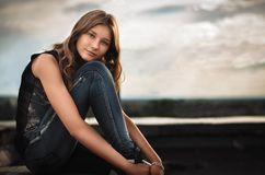 Girl on the Roof. Royalty Free Stock Photography