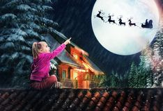 Girl on the roof in The Christmas eve Royalty Free Stock Photos