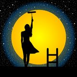 Girl paints the moon and the stars. Girl on the roof painting the moon and the stars Royalty Free Stock Images