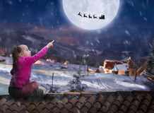 Girl on the roof in winter night Royalty Free Stock Photography