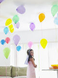 Girl In Room Full Of Balloons Stock Photography