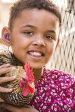 Girl With Rooster Royalty Free Stock Images