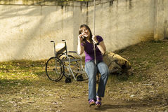 Girl on Rope Swing Stock Image