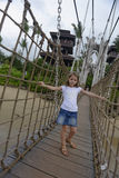 Girl on a rope wood bridge, Sentosa Island Royalty Free Stock Images