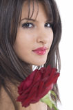 Girl and rose. Pretty girl with red rose in her hand Stock Photo