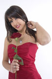 Girl and rose. Pretty girl with red rose in her hand Royalty Free Stock Photos