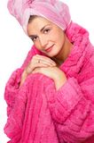 Girl in rose bathrobe. Picture of a beautiful girl in rose bathrobe Royalty Free Stock Photo