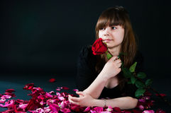 Girl with a rose on a black background Stock Photography