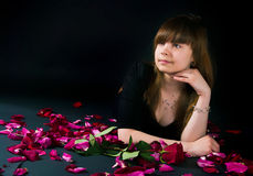 Girl with a rose on a black background Stock Images