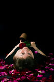 Girl with a rose on a black background Royalty Free Stock Photo
