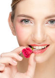 Girl with rose bud in her mouth Stock Image
