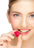 Girl with rose bud in her mouth Royalty Free Stock Photography