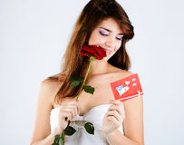 Girl with rose and card Royalty Free Stock Image